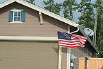 Close up of a house with a Flag