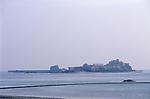 Elizabeth Castle St Helier Jersey. The Channel islands UK 2000s. Sea water black semi circular boundary wall of a beach swimming pool.
