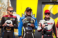 Sep 15, 2019; Mohnton, PA, USA; NHRA top fuel drivers Leah Pritchett (left), Antron Brown (center) and Steve Torrence during the Reading Nationals at Maple Grove Raceway. Mandatory Credit: Mark J. Rebilas-USA TODAY Sports