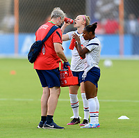 HOUSTON, TX - JUNE 10: Crystal Dunn #19 of the United States and Becky Sauerbrunn #4 take a water break before a game between Portugal and USWNT at BBVA Stadium on June 10, 2021 in Houston, Texas.