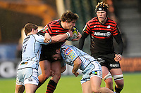 20130127 Copyright onEdition 2013©.Free for editorial use image, please credit: onEdition..Adam Powell of Saracens is tackled by Harry Robinson (left) and Lewis Jones of Cardiff Blues as Tom Jubb of Saracens looks on during the LV= Cup match between Saracens and Cardiff Blues at Allianz Park on Sunday 27th January 2013 (Photo by Rob Munro)..For press contacts contact: Sam Feasey at brandRapport on M: +44 (0)7717 757114 E: SFeasey@brand-rapport.com..If you require a higher resolution image or you have any other onEdition photographic enquiries, please contact onEdition on 0845 900 2 900 or email info@onEdition.com.This image is copyright onEdition 2013©..This image has been supplied by onEdition and must be credited onEdition. The author is asserting his full Moral rights in relation to the publication of this image. Rights for onward transmission of any image or file is not granted or implied. Changing or deleting Copyright information is illegal as specified in the Copyright, Design and Patents Act 1988. If you are in any way unsure of your right to publish this image please contact onEdition on 0845 900 2 900 or email info@onEdition.com