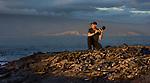 Art Wolfe & marine iguanas, Galapagos Islands, Ecuador