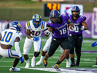 Landon Lucke (16) of Fayetteville runs with the ball against  North Little Rock at Harmon Field , AR, on Friday,September 10, 2021 / Special to NWADG David Beach