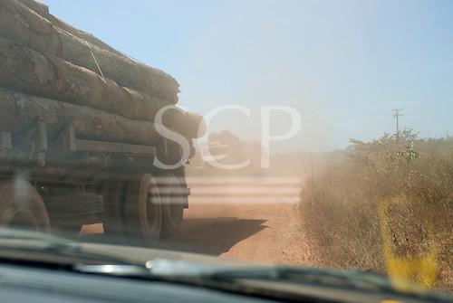 Mato Grosso State, Brazil. Logging trucks on the MT322 (BR080) road.