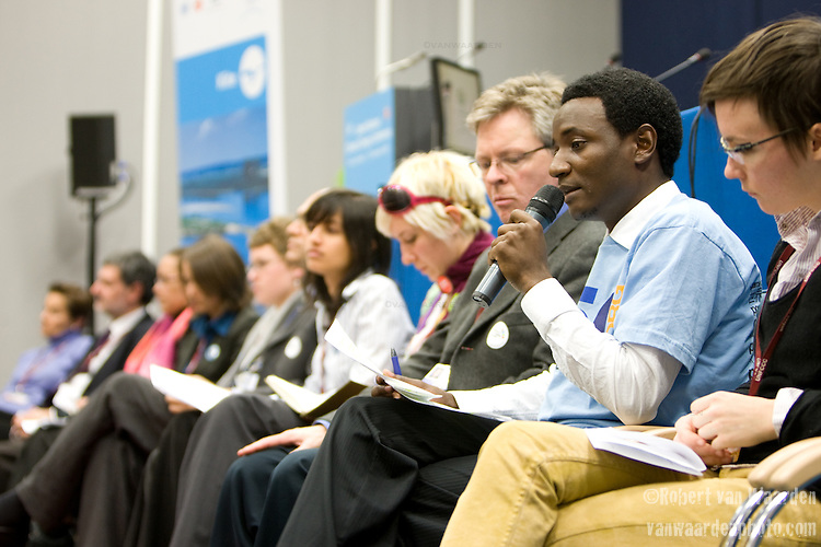 Ely Katembo, speaks during the Intergenerational Inquiry on Climate Solutions. Poznan..UNFCCC COP 14 (©Robert vanWaarden ALL RIGHTS RESERVED)