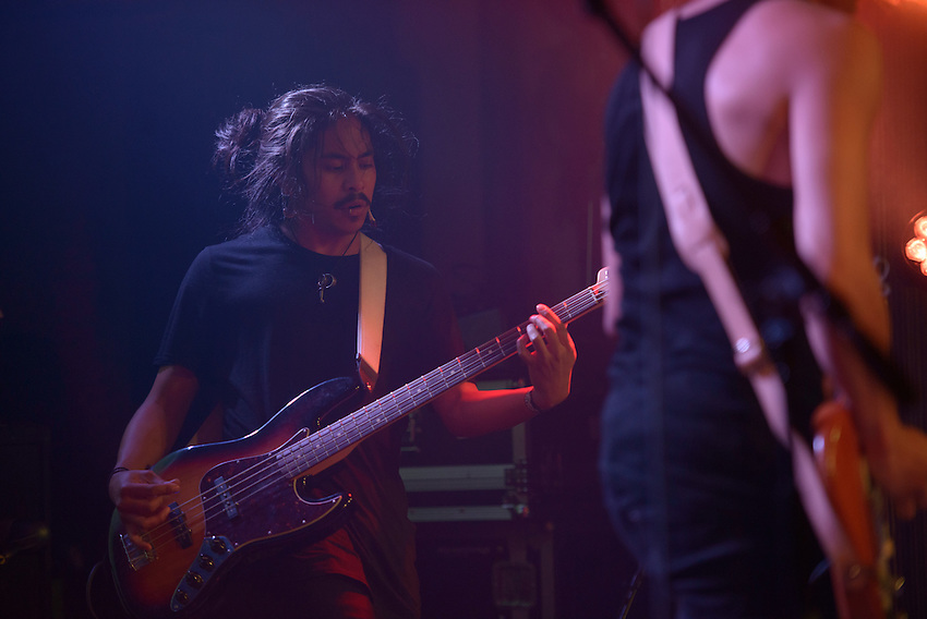 """Turquoise Boy bassist Winston Montecillo performs during the release party for the band's first album """"24 Hours a Night"""" at Williwaw. Photo by James R. Evans"""