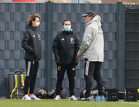 Physiotherapists Fabienne Van De Steene and Jan Van der Jeugt pictured with assistant coach Kris Van Der Haegen during the training session of the Belgian Women's National Team ahead of a friendly female soccer game between the national teams of Germany and Belgium , called the Red Flames in a pre - bid tournament called Three Nations One Goal with the national teams from Belgium , The Netherlands and Germany towards a bid for the hosting of the 2027 FIFA Women's World Cup ,on 19th of February 2021 at Proximus Basecamp. PHOTO: SEVIL OKTEM | SPORTPIX.BE