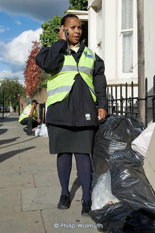 Westminster City Guardians Rosaline Herman and Cory Wharton-Marcolm III with dumped rubbish in the Harrow Road area, North Paddington, London.