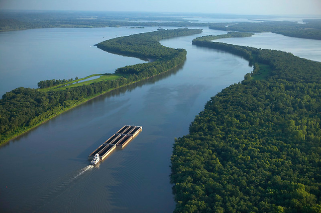 Barge on Illinois River at Peoria Illinois. Aerial view south