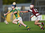 Shane Taylor of Broadford in action against Arthur Rogers of St Joseph's Doora Barefield during their Intermediate county final in Cusack Park. Photograph by John Kelly.