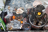 India, Rishikesh.  Oil Lamp and Incense Burn in Streetside Shrine.