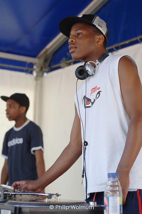 Rap performance by members of Fisherton Estate Youth Club at Church Street Summer Festival 2005, Paddington, London.