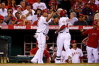 Albert Pujols #5 of the Los Angeles Angels greets teammate Howie Kendrick #47 during a game against the Detroit Tigers at Angel Stadium on September 7, 2012 in Anaheim, California. Los Angeles defeated Detroit 3-2. (Larry Goren/Four Seam Images)