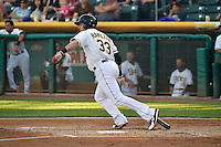 Josh Hamilton (33) of the Salt Lake Bees at bat against the Albuquerque Isotopes at Smith's Ballpark on May 22, 2014 in Salt Lake City, Utah.  The 2010 American League MVP from the Los Angeles Angels of Anaheim joined the Bees for a rehab stint. (Stephen Smith/Four Seam Images)