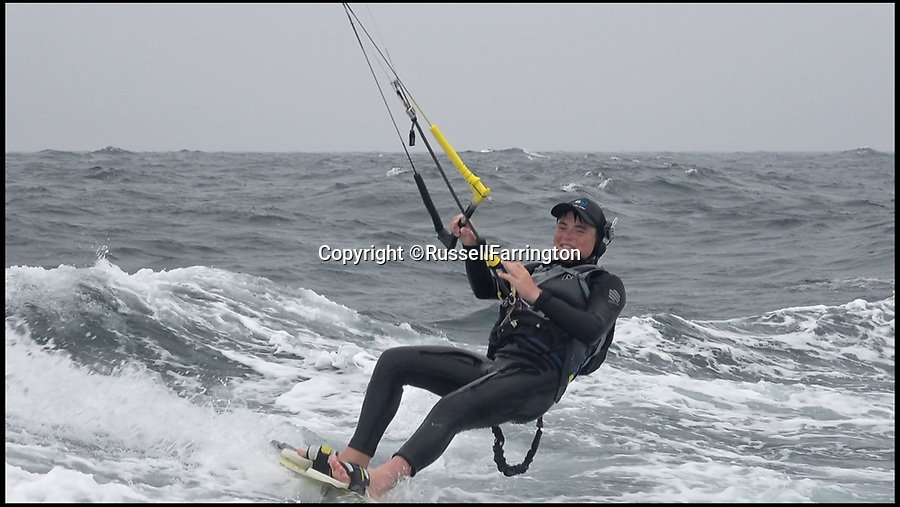 BNPS.co.uk (01202 558833)Pic: RussellFarrington/BNPS<br /> <br /> A Screenshot from the video showing Adam Farrington (14) battling rough seas crossing the the English Channel.<br /> <br /> A 14 year old British boy is thought to have become the youngest person to kitesurf across the English Channel.<br /> <br /> Adam Farrington battled 25mph winds and a rough sea to complete the 69 mile journey between Poole in Dorset and the French city of Cherbourg in five hours and 19 minutes.<br /> <br /> He endured a dozen 'wipeouts' in treacherous conditions but stuck gamely to his task, pushing through the pain barrier when his legs started cramping 10 miles from the French coast.<br /> <br /> His perseverance paid off as he eventually reached the beach, by which point he was so exhausted he could no longer walk.