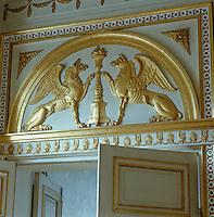 An overdoor in Queen Charlotte's Small Bedroom incorporates Carl XIV Johan's griffins