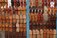 Display of slippers for sale at market (full frame) (Licence this image exclusively with Getty: http://www.gettyimages.com/detail/sb10065145bg-001 )