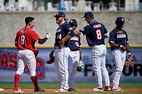 Base runner Alex Ulloa (8) talks with first baseman Tommy White (44), shortstop Termarr Johnson (42), second baseman Kahlil Watson (6), and first baseman Cody Schrier (8) during the Baseball Factory All-Star Classic at Dr. Pepper Ballpark on October 4, 2020 in Frisco, Texas.  (Mike Augustin/Four Seam Images)