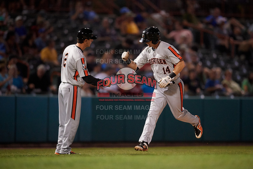 Aberdeen IronBirds left fielder Robert Neustrom (14) is congratulated by manager Kyle Moore (2) as he rounds third base after hitting a home run in the top of the fifth inning during a game against the Tri-City ValleyCats on August 27, 2018 at Joseph L. Bruno Stadium in Troy, New York.  Aberdeen defeated Tri-City 11-5.  (Mike Janes/Four Seam Images)