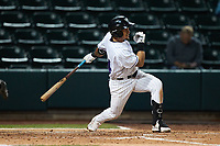 Jose Rodriguez (24) of the Winston-Salem Dash follows through on his swing against the Greensboro Grasshoppers at Truist Stadium on August 11, 2021 in Winston-Salem, North Carolina. (Brian Westerholt/Four Seam Images)