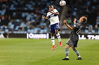 SAINT PAUL, MN - MAY 12: Deiber Caicedo #7 of Vancouver Whitecaps FC and Chase Gasper #77 of Minnesota United FC battle for the ball during a game between Vancouver Whitecaps and Minnesota United FC at Allianz Field on May 12, 2021 in Saint Paul, Minnesota.