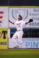 Chattanooga Lookouts shortstop Jorge Polanco (11) calls for a pop up during a game against the Jacksonville Suns on April 30, 2015 at AT&T Field in Chattanooga, Tennessee.  Jacksonville defeated Chattanooga 6-4.  (Mike Janes/Four Seam Images)