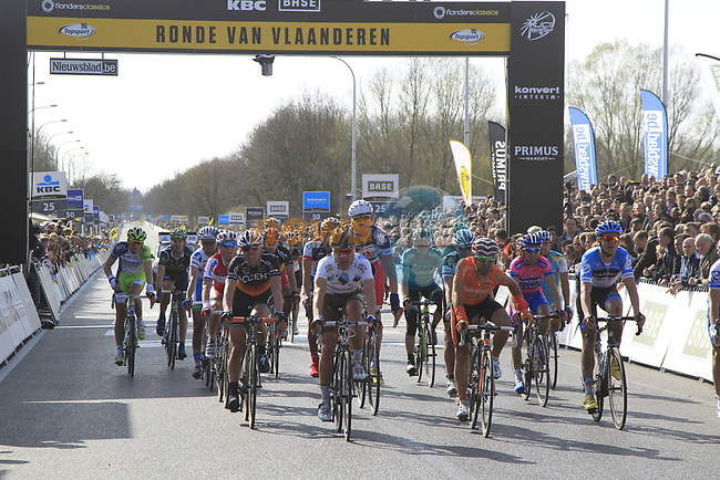 The main bunch crosses the finish line in Oudenaarde at the end of the 96th edition of The Tour of Flanders 2012 , running 256.9km from Bruges to Oudenaarde, Belgium. 1st April 2012. <br /> (Photo by Eoin Clarke/NEWSFILE).