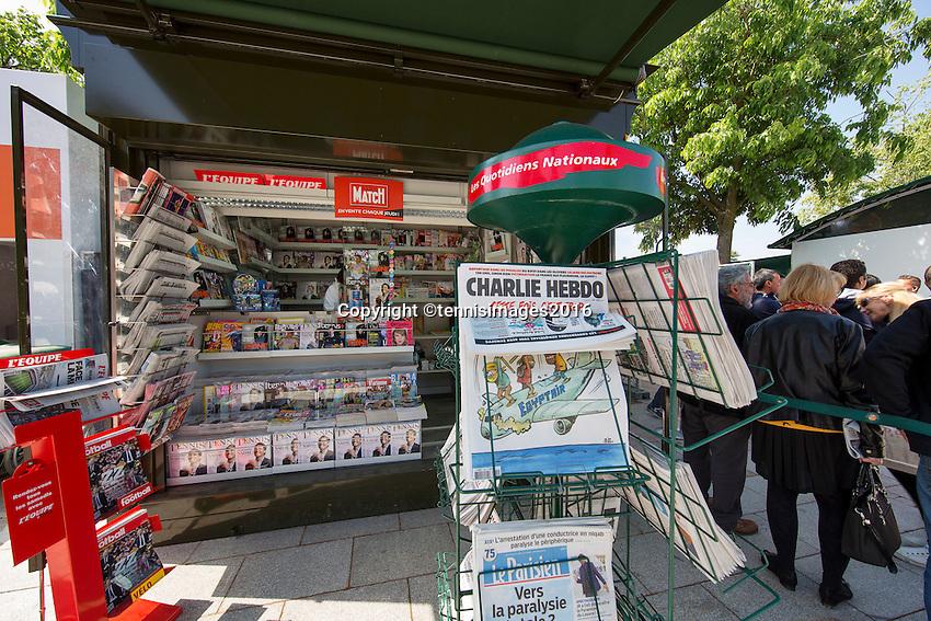 Paris, France, 25 June, 2016, Tennis, Roland Garros,  ambiance, news stand with Charlie Hebdo<br /> Photo: Henk Koster/tennisimages.com