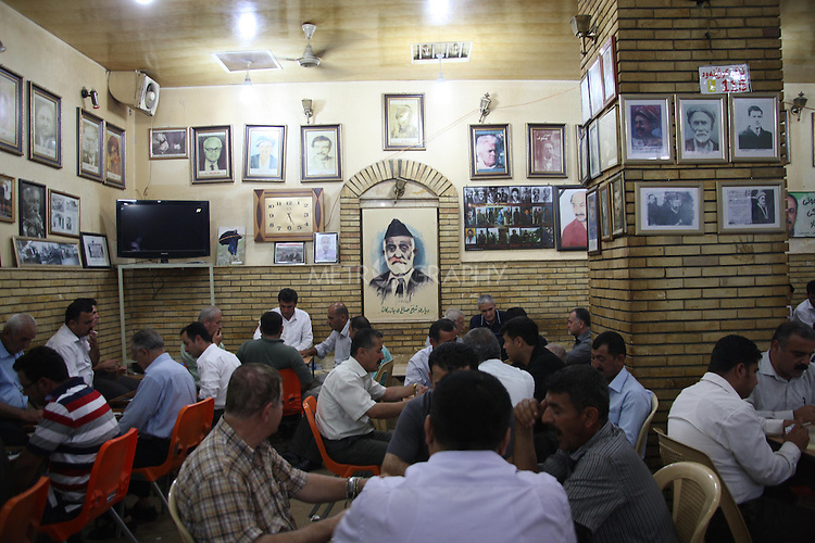 SULAIMANIYAH, IRAQ: The interior of the Shab Cafe...Mahmoud Mohamed Salh, is a portrait artist in the Shab Cafe in Sulaymaniyah. Mahmoud, a former PeshMerga (Iraqi Kurdish guerilla), does not own a house and is not married. He lives in his brother's house on the outskirts of Sulaymaniyah. Mahmoud draws portraits for $4...Photo by Asaad Zwain/Metrography
