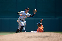 Pittsburgh Pirates Wyatt Mathisen (10) catches a throw down as Kirvin Moesquit (52) slides in during an Instructional League game against the Baltimore Orioles on September 27, 2017 at Ed Smith Stadium in Sarasota, Florida.  (Mike Janes/Four Seam Images)
