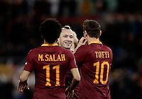 Calcio, Serie A: Roma, stadio Olimpico, 19 febbraio 2017.<br /> Roma's Radja Nainggolan (c) celebrates with his teammates Mohamed Salah (l) and Francesco Tott (r)i after scoring during the Italian Serie A football match between As Roma and Torino at Rome's Olympic stadium, on February 19, 2017.<br /> UPDATE IMAGES PRESS/Isabella Bonotto