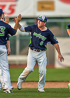 12 July 2015: Vermont Lake Monsters infielder Trace Loehr gets a high-five after the game against the West Virginia Black Bears at Centennial Field in Burlington, Vermont. The Lake Monsters came back from a 4-0 deficit to defeat the Black Bears 5-4 in NY Penn League action. Mandatory Credit: Ed Wolfstein Photo *** RAW Image File Available ****