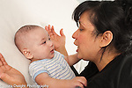 5 month old baby boy with mother listening to her talk