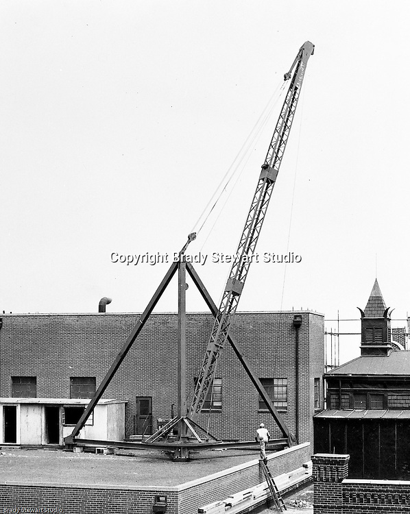 Client: Equipment Corporation of America<br /> Ad Agency: Equipment Corp of America Marking<br /> Product: Rooftop Crane<br /> Location: Rooftop of building in Pittsburgh<br /> <br /> Heating and Air Conditioning contractor using a crane from the Equipment Corporation of America to install an air conditioning unit on top of a building in downtown Pittsburgh.<br />  <br /> ECA opened its Pittsburgh location in the early 1920s in Coraopolis PA.