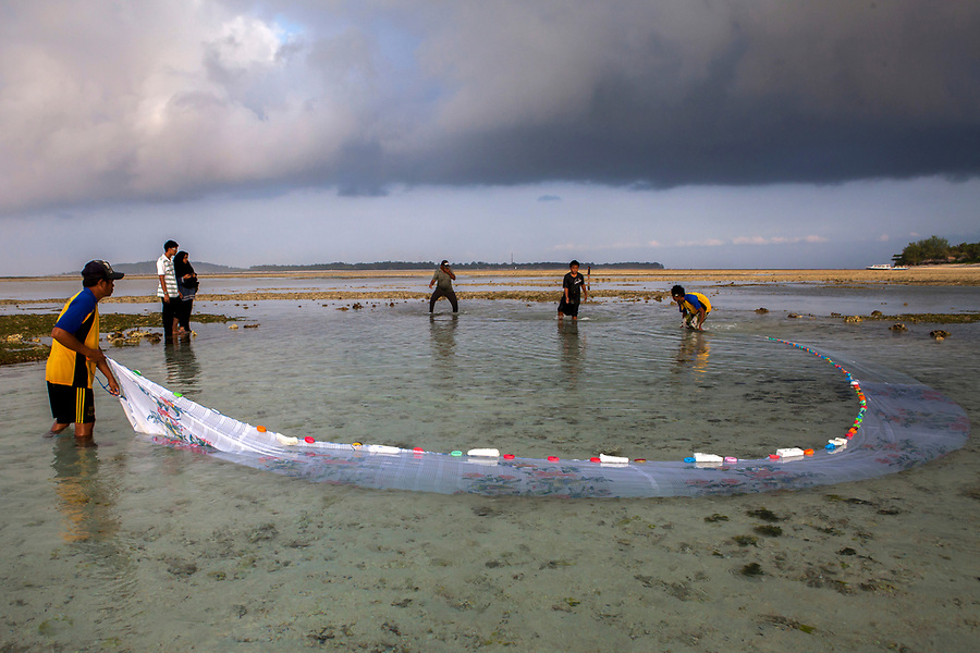 "Fishermen catch ""finger fish"" in nets on the tiny island of Gili Air, Indonesia."