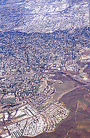 View out of airplane window of small town<br />