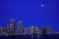 Honolulu at night with the moon.
