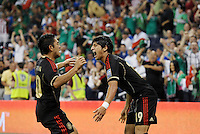 Marco Fabian (10) and Alan Pulido (19) Mexico celebrate a goal... Mexico defeated Canada 3-1 in Olympic Qualifying semi final at LIVESTRONG Sporting Park, Kansas City, Kansas.