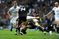 Richie McCaw of New Zealand (right) gets to grips with Courtney Lawes of England during the QBE Autumn International match between England and New Zealand at Twickenham on Saturday 16th November 2013 (Photo by Rob Munro)