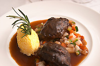 Joues de Boeuf, pigs' cheeks, served with small diced vegetables and polenta shaped like an egg and a twig of rosemary, at the gastronomic restaurant Maceo in Paris