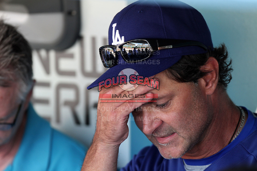 Los Angeles Dodgers manager Don Mattingly #8 before a game against the Cincinnati Reds at Dodger Stadium on June 14, 2011 in Los Angeles,California. (Larry Goren/Four Seam Images)