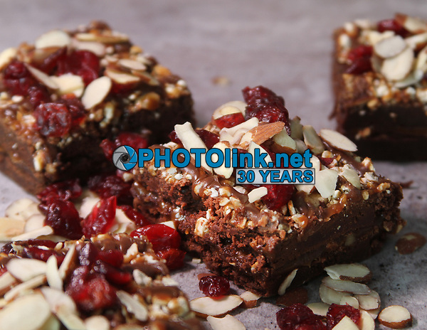 Turtle brownies, topped with sliced almonds, dried cranberries, chocolate ganache, caramel drizzle, country pretzel pieces and crumbled pecans. <br /> Photo By Adam Scull/PHOTOlink.net
