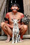 Portrait of a Yanomamo man and hunting dog, Parima-Tapirapeco National Park, Venezuela