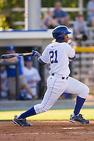 Reggie Taylor #21 of the Burlington Royals follows through on his swing against the Kernersville Bulldogs in an exhibition game at Burlington Athletic Stadium June20, 2010, in Burlington, North Carolina.  Photo by Brian Westerholt / Four Seam Images