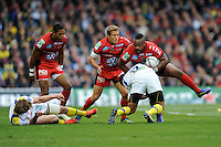 Mathieu Bastareaud of RC Toulon is tackled by Wesley Fofana of ASM Clermont Auvergne during the Heineken Cup Final between ASM Clermont Auvergne and RC Toulon at the Aviva Stadium, Dublin on Saturday 18th May 2013 (Photo by Rob Munro)
