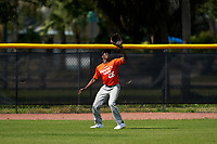 Outfielder Joshua Bussey (25) catches a fly ball during the Perfect Game National Underclass East Showcase on January 23, 2021 at Baseball City in St. Petersburg, Florida.  (Mike Janes/Four Seam Images)
