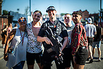 © Joel Goodman - 07973 332324 - all rights reserved . 25/08/2019. Manchester, UK. An armed police officer on patrol at the venue poses with fans of Ariana Grande and other musical acts , as they gather at Mayfield Depot ahead of performances this evening . Manchester's annual Gay Pride festival , which is the largest of its type in Europe , celebrates LGBTQ+ life . Photo credit : Joel Goodman