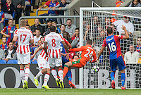 James Tomkins of Crystal Palace scores the first goal during the Premier League match between Crystal Palace and Stoke City at Selhurst Park, London, England on 18 September 2016. Photo by Andy Rowland / PRiME Media Images.