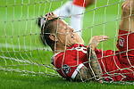 Euro 2012 Qualifying match - Wales Craig Bellamy finds himself in the back of the Montenegro net after a second half attack on goal at the Cardiff City Stadium...
