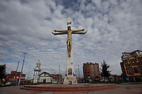 A view of a Catholic Croos in a street plaza.Just 25 years ago it was a small group of houses around La Paz  airport, at an altitude of 12,000 feet. Now El Alto city  has  nearly one million people, surpassing even the capital of Bolivia, and it is the city of Latin America that grew faster .<br /> It is also a paradigmatic city of the troubles  and traumas of the country. There got refugee thousands of miners that lost  their jobs in 90 ´s after the privatization and closure of many mines. The peasants expelled by the lack of land or low prices for their production. Also many who did not want to live in regions where coca  growers and the Army  faced with violence.<br /> In short, anyone who did not have anything at all and was looking for a place to survive ended up in El Alto.<br /> Today is an amazing city. Not only for its size. Also by showing how its inhabitants,the poorest of the poor in one of the poorest countries in Latin America, managed to get into society, to get some economic development, to replace their firs  cardboard houses with  new ones made with bricks ,  to trace its streets,  to raise their clubs, churches and schools for their children.<br /> Better or worse, some have managed to become a sort of middle class, a section of the society that sociologists call  emerging sectors. Many, maybe  most of them, remain for statistics as  poor. But clearly  all of them have the feeling they got  for their children a better life than the one they had to face themselves .